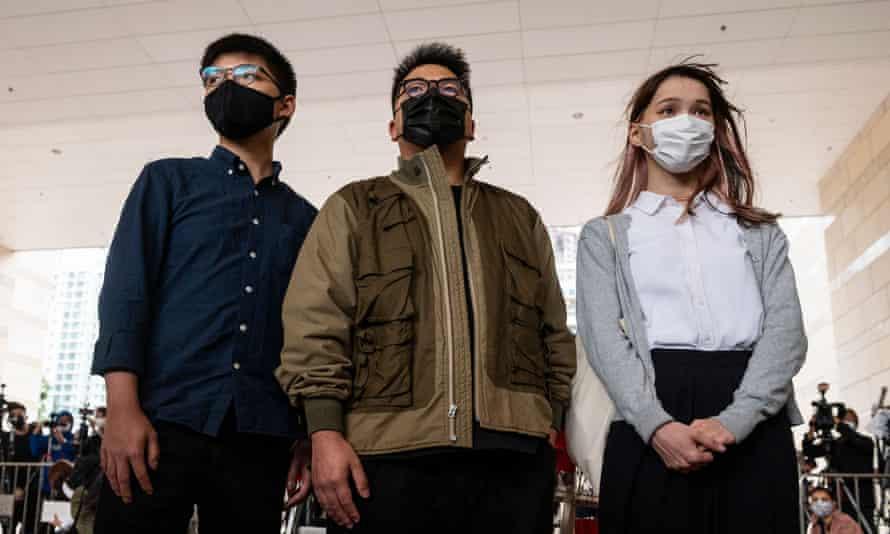 Hong Kong pro-democracy protesters Joshua Wong (L), Ivan Lam (C), and Agnes Chow (R)