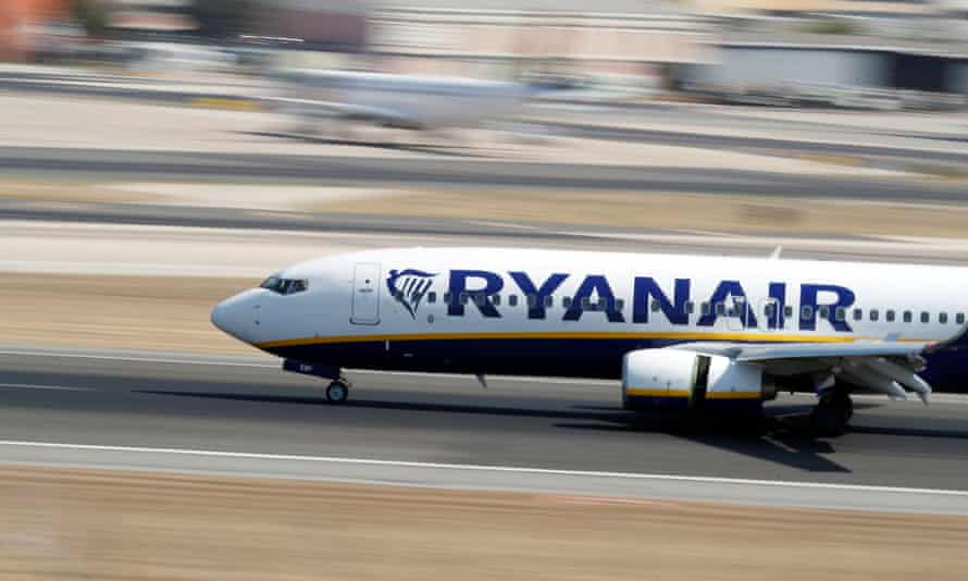 A Ryanair Boeing 737 plane lands at Lisbon's airport.