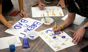 Bristol University students prepare a banner and placards for the People's Vote march in London.
