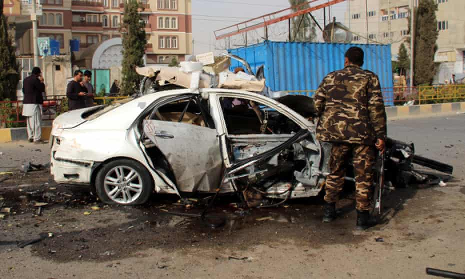 Afghan security officials inspect the scene of a blast in Lashkargah, Afghanistan, which killed the journalist Elyas Dayee in November 2020