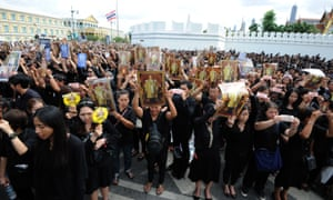 Authorities say 10,000 mourners will be permitted to enter the throne hall, where the king's body is lying, per day.