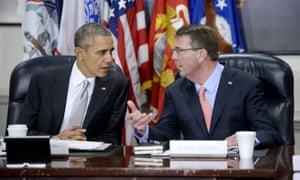 President Barack Obama talks to defence secretary Ashton Carter