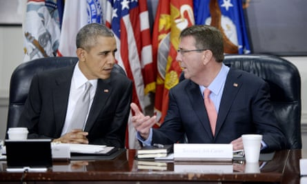 President Barack Obama talks to defence secretary Ashton Carter
