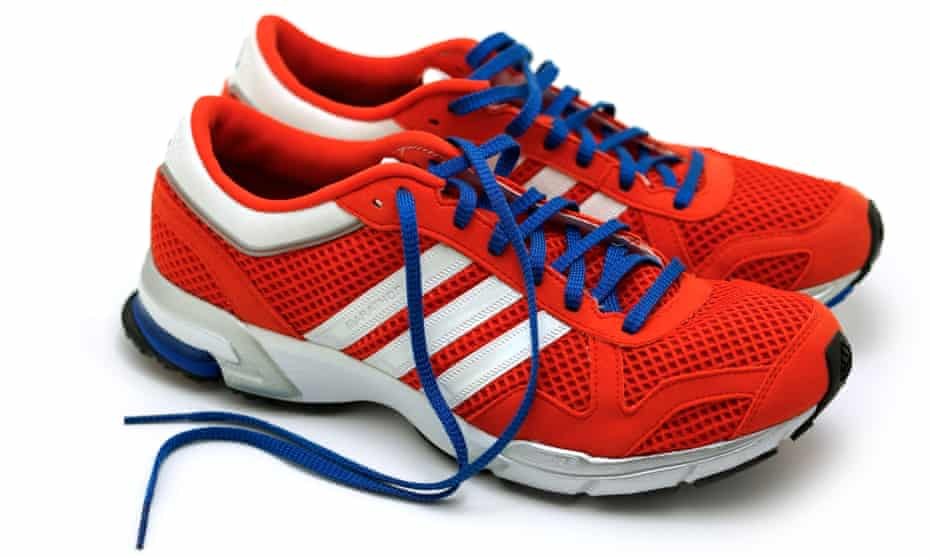 Pair of trainers with toe box curved upwards
