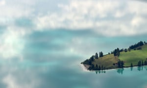 Clouds reflect in the water of lake Walchensee in the German Alps