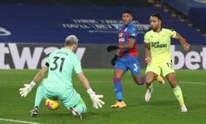 Newcastle United's Callum Wilson slips the ball under Guaita to score the opening goal.