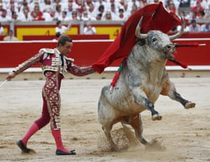 Spanish bullfighter Juan Bautista fights with his bull in the Festival of San Fermin in the arena