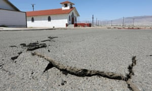 Cracks in the street next to church after a powerful magnitude 7.1 earthquake broke, triggered by a 6.4 the previous day, near the epicenter in Trona, California, 6 July 2019.