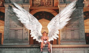 A model in giant Icarus feather wings looks down from the first floor balcony in the Ecole des Beaux-Arts in Paris, as a decoration for the Givenchy's spring/summer Haute Couture collections designed by British designer Alexander McQueen, 19 January 1997.