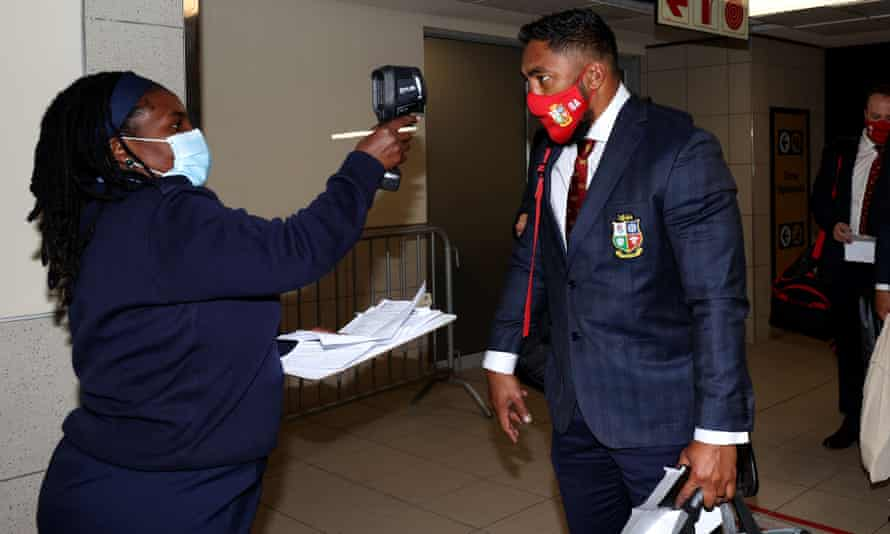 Bundee Aki's temperature is checked upon arrival in South Africa.
