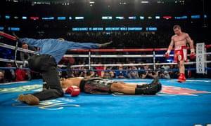 Canelo Álvarez walks around the ring after knocking out Amir Khan
