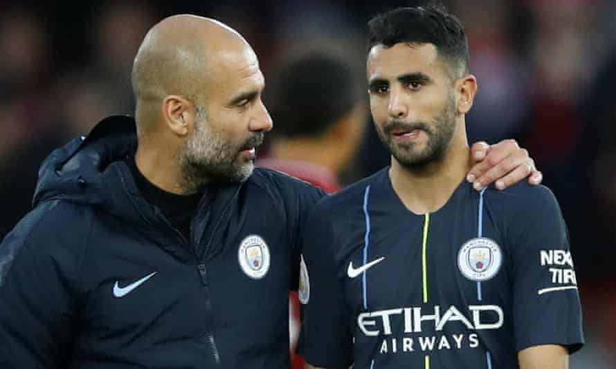 Pep Guardiola consoles Riyad Mahrez after the forward missed a penalty at Anfield last season