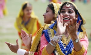 Indian students wearing traditional Punjabi attire perform Giddha folk dance from Punjab as they take part in the full and final dress rehearsal for India's independence day parade and celebrations in Amritsar, India