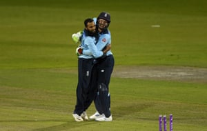 Buttler and Rashid celebrate victory.