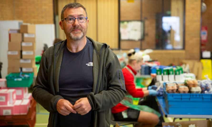 Stephen Henry, who is helping pack food boxes