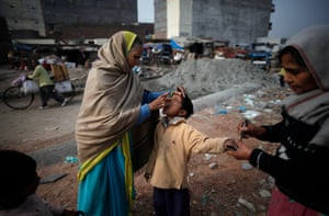 A child is the oral polio vaccine during an anti-polio drive in New Delhi, India.