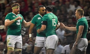 Ireland's Felix Jones, second right, is congratulated by team-mates Jamie Heaslip, Simon Zebo and Keith Earls after hsi try against Wales.