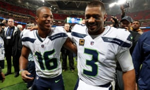 Tyler Lockett celebrates with his quarterback Russell Wilson after the final whistle.