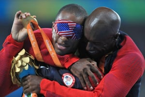 USA's David Brown celebrates on the podium after wining the gold medal for the men's 100m T11 final