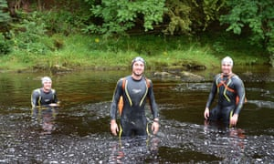 Calum Hudson (centre) in the river Eden with his brothers Jack (left) and Robbie (right)