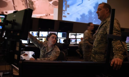 Analysts working in the top-secret SCIF room at McConnell air force base in Wichita.