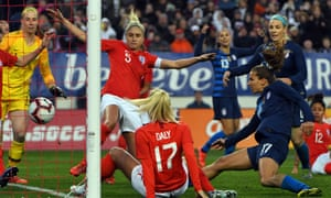 Tobin Heath scores the USA's second, beating a group of England defenders to equalise.