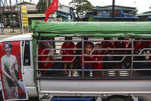 Yangon, Myanmar, Children cheer in a truck carrying an image of Myanmar leader Aung San Suu Kyi