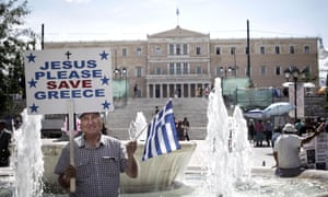 A Greek man stands in front of the parliament building in Athens