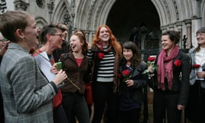 Friends and family of fracking protesters Simon Blevins, Richard Roberts and Rich Loizou celebrate outside the appeal court after their sentences are overturned.
