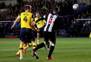 Oxford United's Nathan Holland side-foots in the late equaliser.