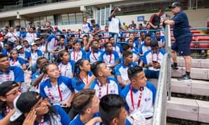 The national team coach Hernán Darío 'Bolillo' Gómez talks to kids at pre-World Cup training in Panama City.