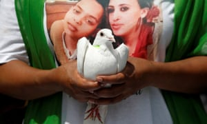 A man holds a dove during commemorations