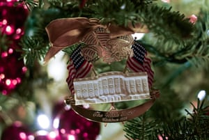 A Christmas ornament is seen in the library during a media preview of the 2019 White House holiday decorations.