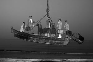 Seven Intellectuals in Bamboo Forest, featuring seven people in a boat suspended in the air, a photograph by Yang Fudong