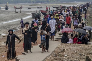 Rohingya Muslims, who crossed over from Myanmar into Bangladesh, walk towards the nearest refugee camp at Teknaf, Bangladesh