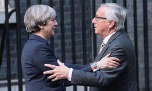 Theresa May greets Jean-Claude Juncker at Downing Street