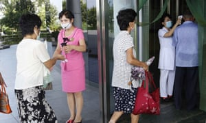Arrivals at the Ryugyong health complex in Pyongyang have their temperature checked, on 31 July
