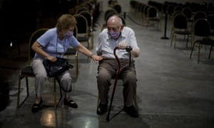 Marta Galmariz Levy sits with her husband Víctor Levy, 86, as he waits to get a shot of the AstraZeneca vaccine for COVID-19 in Buenos Aires, Argentina, Wednesday, Feb. 24, 2021.
