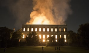 People watch as flames engulf the 200-year-old National Museum of Brazil in Rio de Janeiro on 2 September 2018.