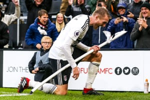 Fulham's André Schürrle celebrates scoring their fourth goal to seal a 4-2 victory over Burnley at Craven Cottage, their first win of the season.