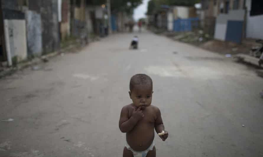 A baby in one of the poorest areas of the City of God favela in Rio de Janeiro. Nationally, the death rate for children up to the age of five also rose by nearly 4% in 2016.