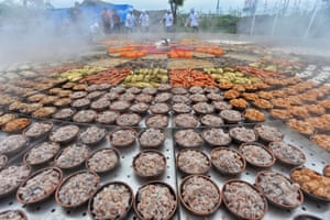 Xiantao, China Food dishes are seen on a giant steamer for an event at in Xiantao in Hubei province