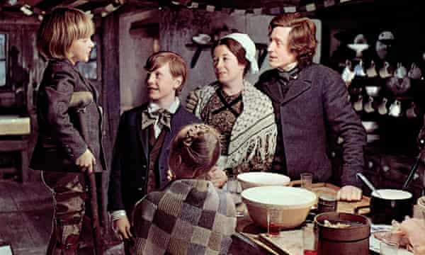 Collings as Bob Cratchit in the 1970 film Scrooge, with Frances Cuka as his wife.
