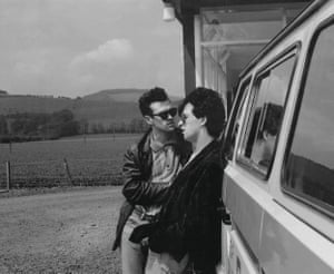Morrissey and Johnny Marr of the Smiths standing by the side of a van in 1984