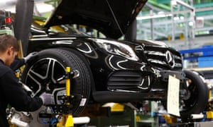 An employee of German car manufacturer Mercedes Benz installs wheel at a A-class model at the production line at the Daimler factory in Rastatt, Germany.