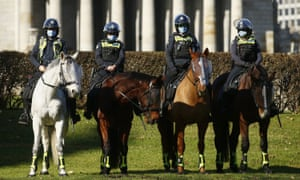 Police prepare to meet anti-mask protesters at the Shrine of Remembrance in Melbourne.