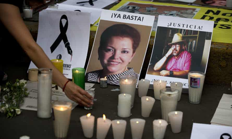 A memorial for murdered journalists Miroslava Breach, left, and Javier Valdez, who were killed in separate attacks in Mexico in 2017.