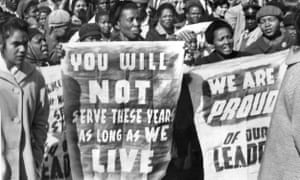 African women demonstrate in front of the Law Courts in Pretoria, 16 June 1964, after the verdict of the Rivonia trial, in which eight men, among them anti-apartheid leader and member of the African National Congress (ANC) Nelson Mandela, were sentenced to life imprisonment. The eight men were accused of conspiracy, sabotage and treason. (Photo credit should read OFF/AFP/Getty Images) HORIZONTAL JUSTICE TRIAL DEMONSTRATION HUMAN RIGHTS APARTHEID ANC WOMAN PLACARD CROWD BLACK POPULATION BLACK POPULATION