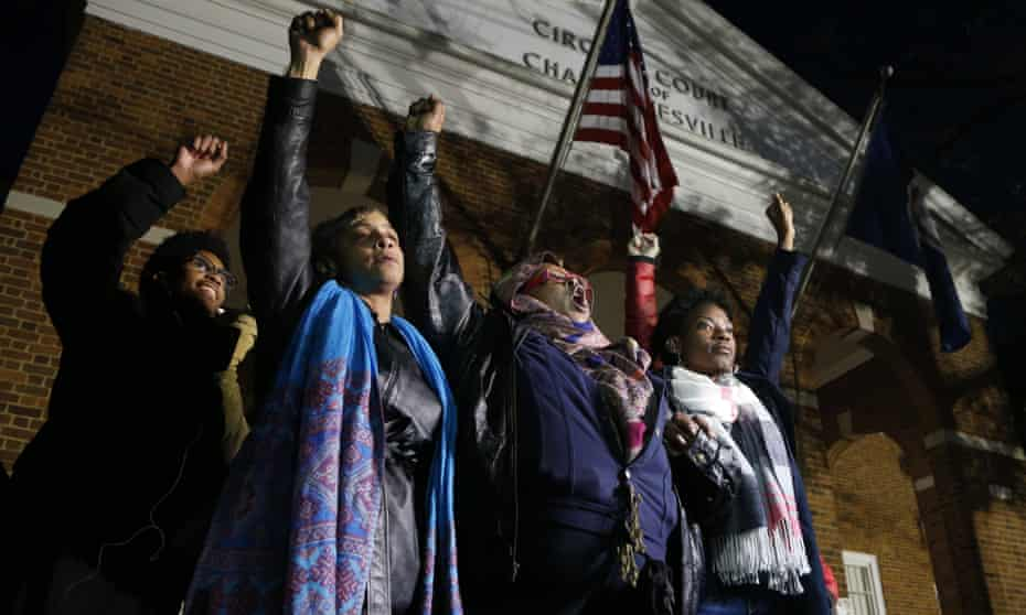 Local activists raise their fists outside Charlottesville general district court after a guilty verdict was reached in the trial of James Fields in Charlottesville, Virginia, on 7 December.