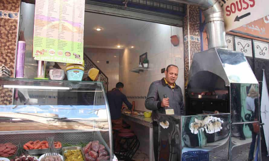 Cook prepares food at Chez Hassan in Marrakech, Morocco.